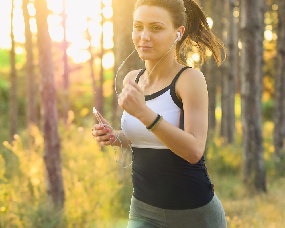 A woman jogs outdoors early morning