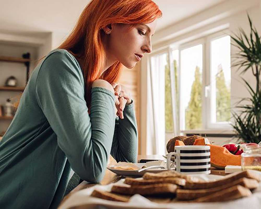 woman sitting in front of foods