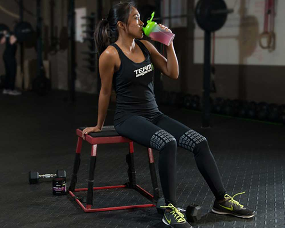 woman drinking protein powder drink