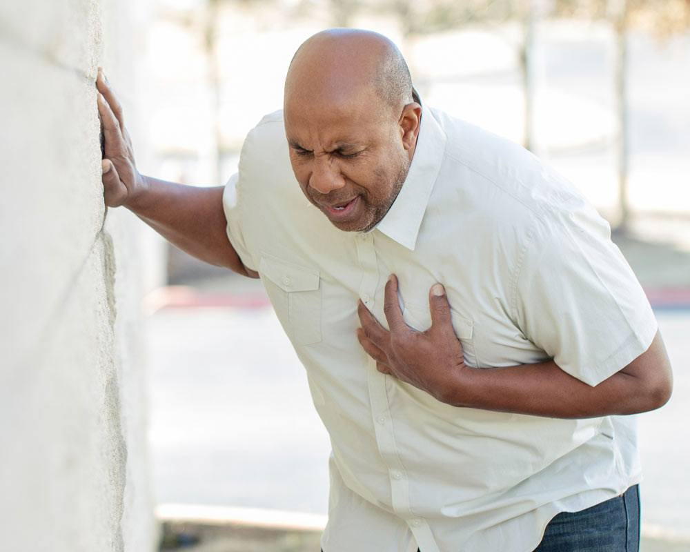 man with chest pain due to heart disease