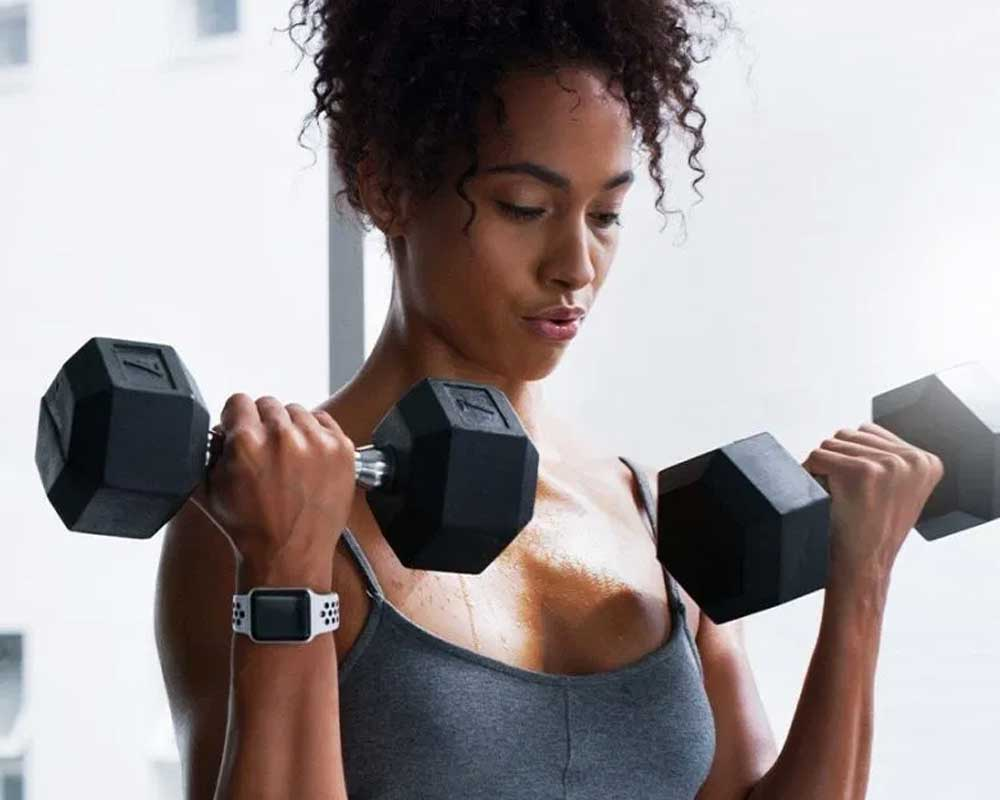 Woman holding dumbell