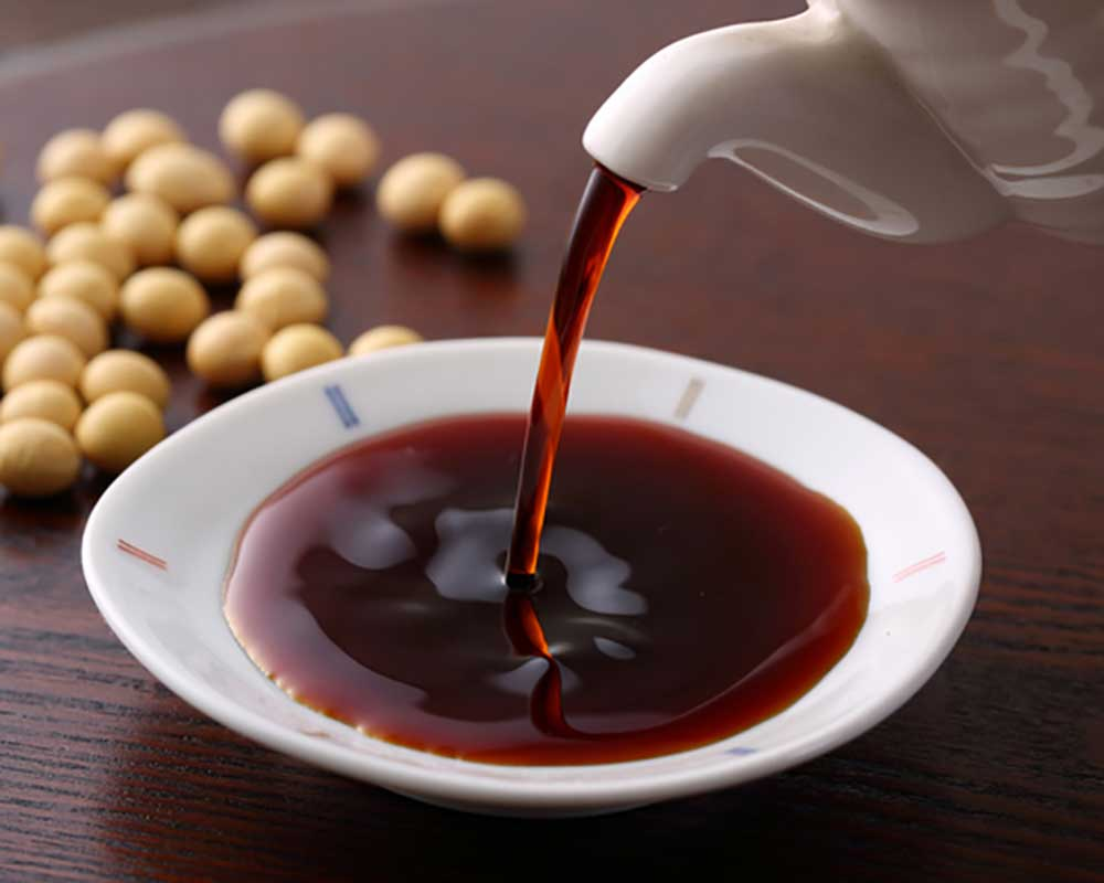 Soy sauce pouring